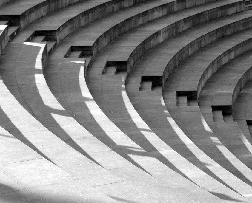 BW Photo of amphitheater steps half-lit with sun