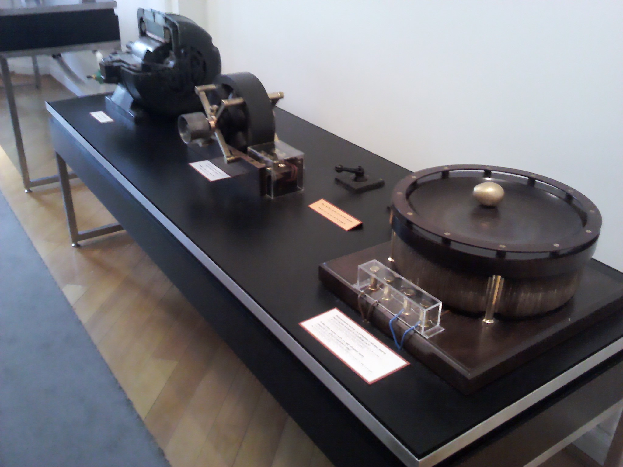 Photo of several of Tesla's inventions in a museum.
